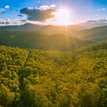 Aerial view of Australian forest and mountains at sunset