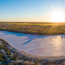 Pink salt lake Hardy at sunset - aerial panoramic landscape