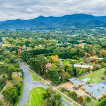 Aerial landscape of rural houses among trees in fall. Healesville, Victoria, Australia
