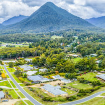Town of Healesville surrounded by mountains in Victoria, Australia - aerial panorama