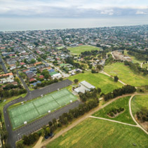 Aerial view of Women's sports club and adjuscent suburban area at Bcentennial Park in Chelsea, Melbourne, Australia