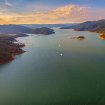 Aerial panorama of beautiful lake and mountains at sunset