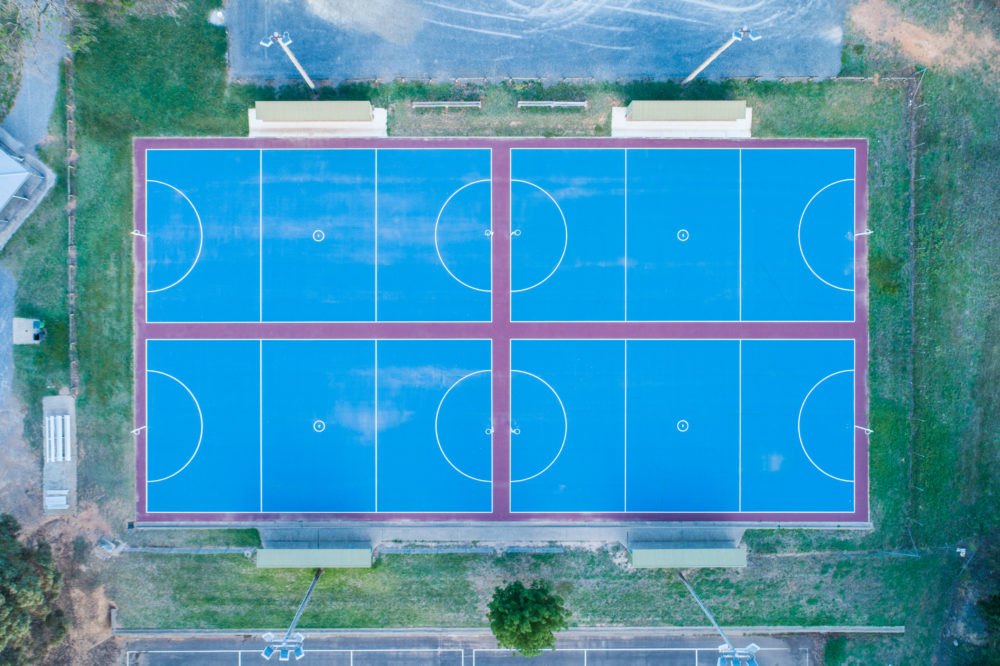 Looking down at new blue netball courts - aerial view
