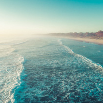 Beautiful sunrise over ocean waves with copy space - dreamy look