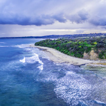 Aerial panoramic landscape of storm clouds over ocean coastline