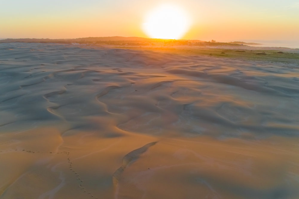 Breathtaking sunrise over famous sand dunes at Anna Bay, New South Wales, Australia