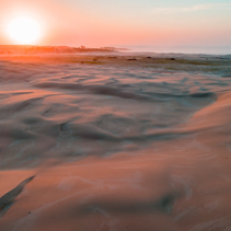 Aerial view of pristine sand dunes at sunrise