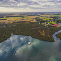 Aerial view of mangroves near ocean coastline and agricultural area in Victoria, Australia