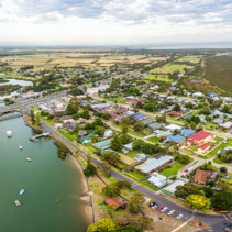 Aerial panorama of small coastal town in Australia