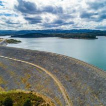 Scenic Cardinia Reservoir Lake and dam wall on cloudy day - aerial view