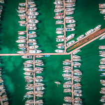 Looking straight down at moored yachts in beautiful marina