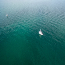 Aerial image of two sailing sailboats