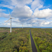 Aerial view of wind turbines and rural road in Australia