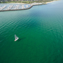 Aerial image of boat sailing near Sandringham Marina. Melbourne, Victoria, Australia