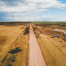 Unsealed road in Australian outback - aerial landscape