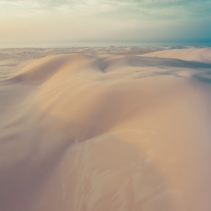 Beautiful sand dunes at sunset - dreamy look, aerial view