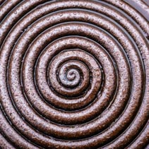 Wet metal spiral abstract background overlay
