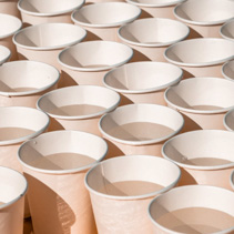 Paper cups filled with water - light and shadow geometric pattern