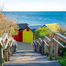 Stairs leading to the colorful famous beach huts on Brighton Beach, Melbourne, Australia