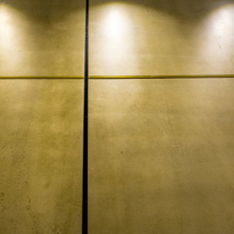 Polished concrete interior wall panels in diminishing perspective and dim light