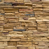 Wall made of decorative stones background texture