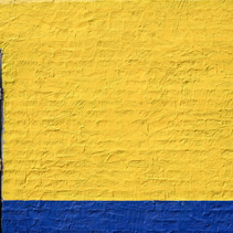 Painted yellow and blue brick wall with metal door and copy space