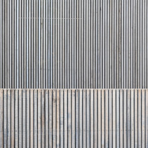 Modern building exterior made of wooden planks background with text space