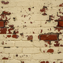 Beige paint peeling off retro brick wall background