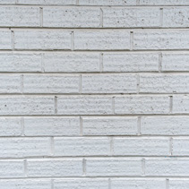 Slim modern brick wall painted in white background texture