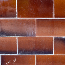 Brown-orange tiles in shape of bricks background texture