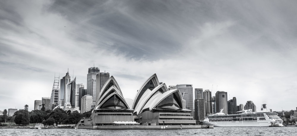 Sydney's Skyline with the Opera House and large cruise ship in t