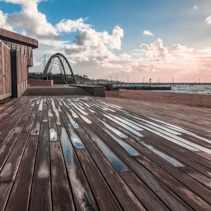 Wooden boardwalk near Frankston Yacht club and footbridge at sunset. Melbourne, Australia