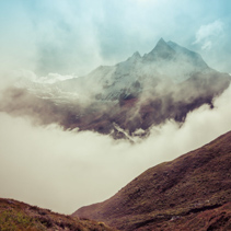 The Sacred Fishtail Mountain revealing through high clouds. Annapurna mountain range, Himalayas, Nepal