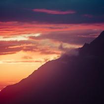 Sun setting behind a mountain. Orange landscape of Himalayas, Nepal