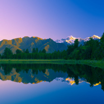 Twin Peaks reflect in the beautiful Lake Matheson at sunset, Southern Alps, South Island, New Zealand