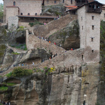 Tourists walking up the stairs into the Holy Monastery Of Great Meteoron in Meteora, Greece.