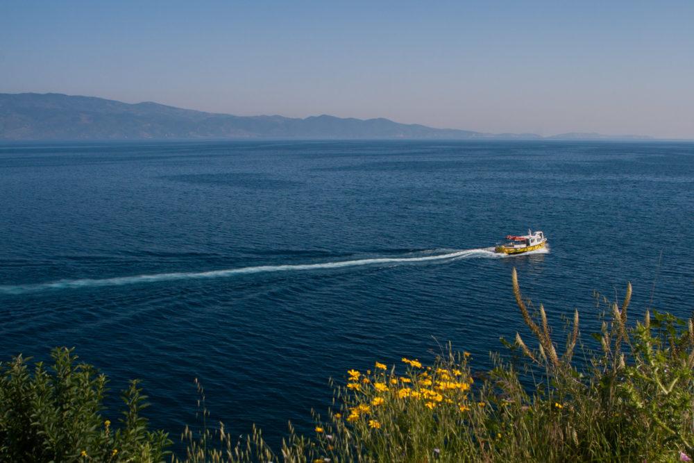 Boat sailing the mediterranean sea, near Hydra island, Greece.