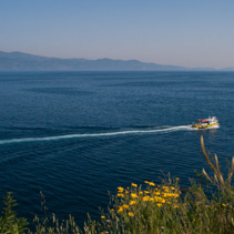 Boat sailing the mediterranean sea, near Hydra island, Greece.