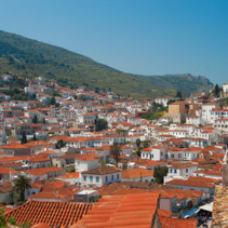 Red rooftops of houses on Hydra Island, Greece