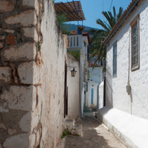 Narrow passage between houses, Hydra Island, Greece.