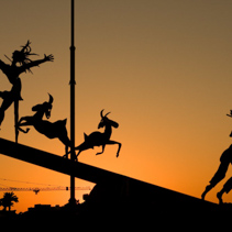 Modern fairy-tale themed sculpture silhouette at sunset