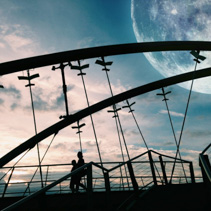 Fantasy landscape - silhouettes of two people walking a bridge with huge moon visible in the sky. Elements of this image are furnished by NASA