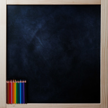Square blackboard with colored pencils.