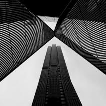 Melbourne CBD architecture - metal scultpture and skyscraper in black and white