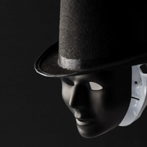 Black and white masks wearing black top hat isolated on black background with copy space. Hypocricy and insincerity concept