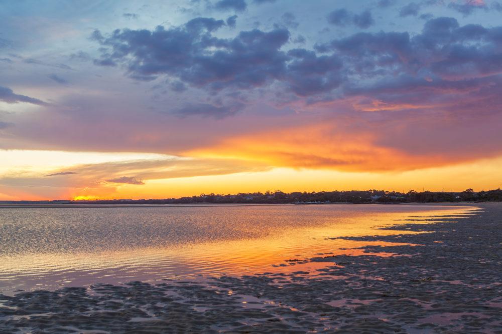 Vivid glowing sunset at Inverloch foreshore beach, Australia
