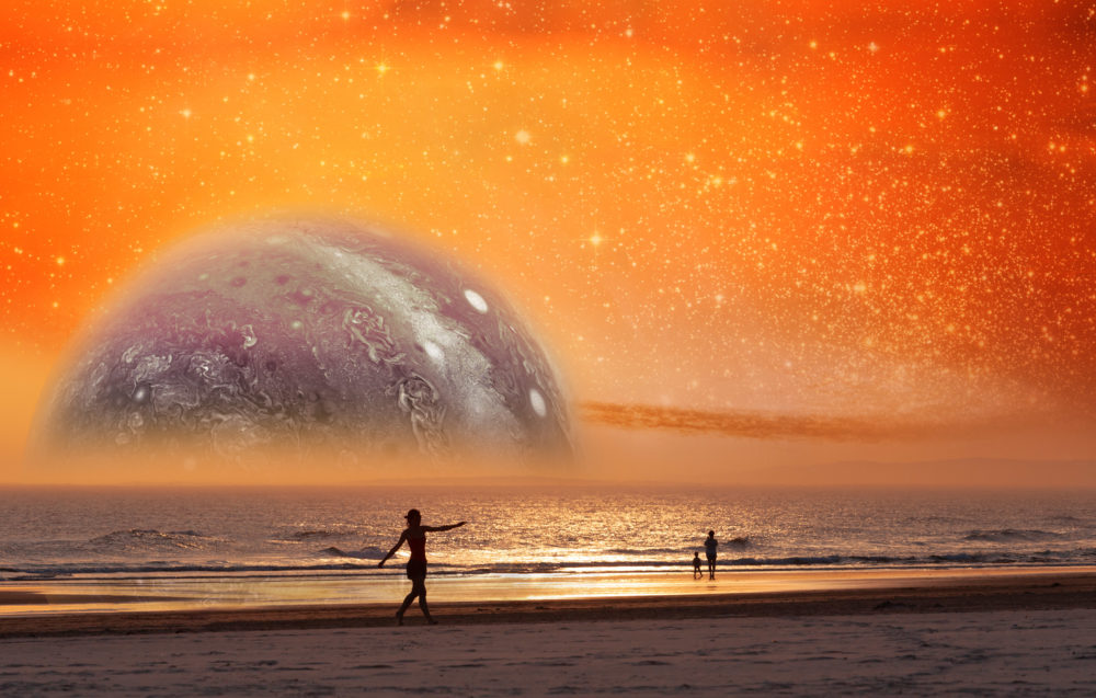 Unreal landscape of dancer silhouette dancing on the beach of alien planet at sunset. Elements of this image furnished by NASA