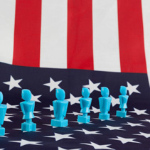 Male and Female figurines on USA flag. Voting, elections, equality, patriotism, independence concept