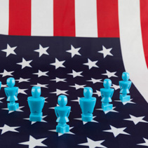 Male and Female figurines on USA flag. Voting, elections, equality, patriotism, independence, and leadership concepts