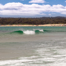 Ocean waves and bathing people at Fingal Bay beach, New South Wales, Australia